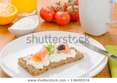 crispbread with salmon and shrimp on a breakfast table stock photo © zerbor