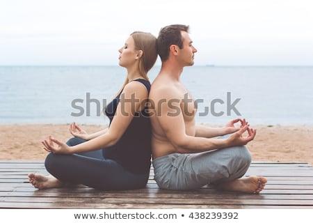 Zdrowych człowiek pilates jogi medytacji plaży Zdjęcia stock © juniart