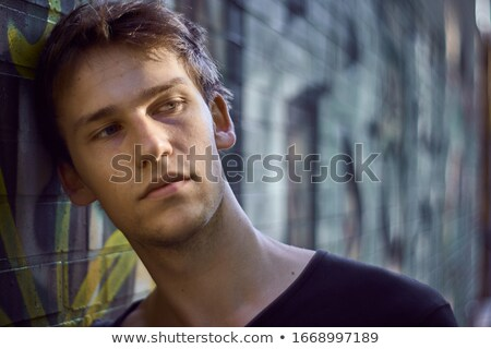 Moody portrait of a handsome young man, looking sad and serene. Stock photo © ajn