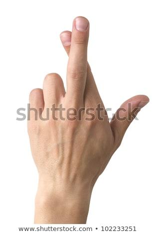 Crossed fingers symbolizing good luck isolated on white Stock photo © bloodua