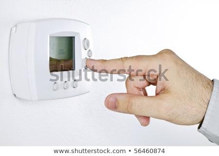 Mão botão digital termóstato energia Foto stock © mady70