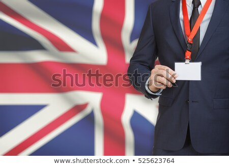Stockfoto: British Businessman Holding Business Card With Great Britain Fla