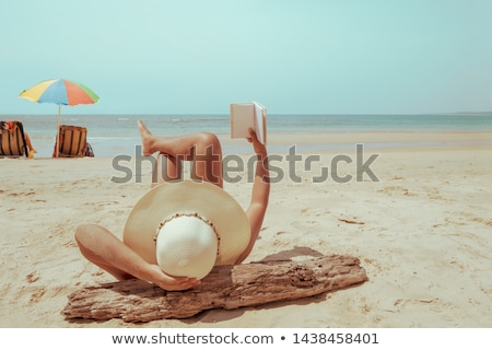 Portrait of young happy woman with travel vacation memories or e Stock photo © HASLOO