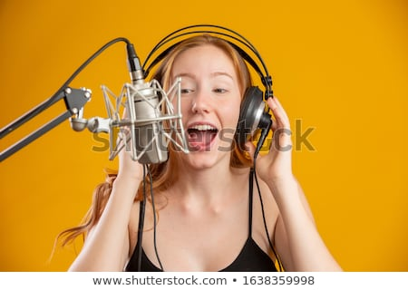 attractive redhead woman with retro microphone stock photo © nejron