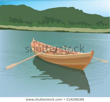Klein roeiboot meer water hout Blauw Stockfoto © michaklootwijk