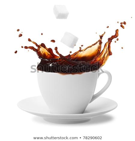 cup of coffee creating splash stock photo © dariazu
