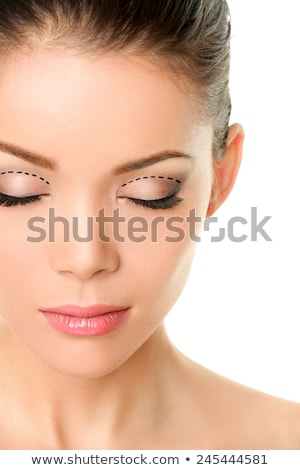 Eyelids plastic surgery concept - asian monolids Stock photo © Maridav