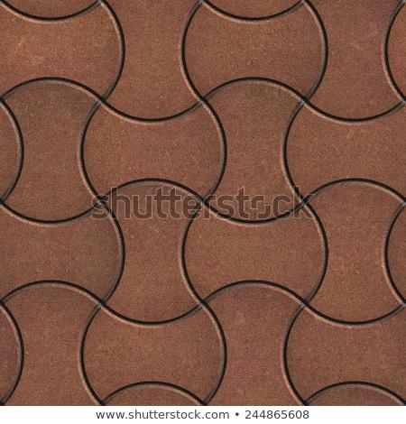 Brown Paving Slabs of the Wavy Form. Stock photo © tashatuvango