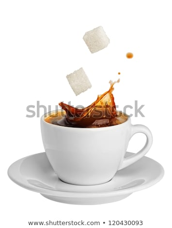 Stock photo: Tea splash with sugar cubes