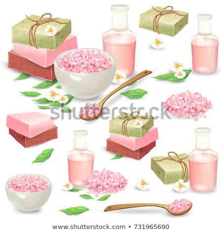 bath salt on a wooden spoon with bath accessories stock photo © kariiika