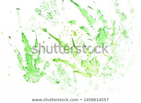 white grunge cannabis leaf on green pattern stock photo © saicle