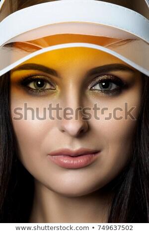 sport woman closeup face sun visor cap Stock photo © lunamarina
