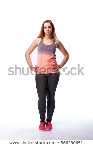 Mooie vrouw strak zwarte broek geïsoleerd witte zwarte Stockfoto © Elnur