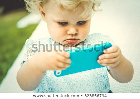 baby with phone 3 stock photo © Paha_L