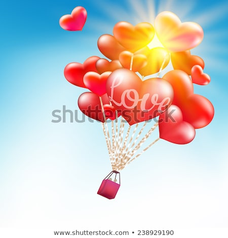 couple in hot air hearts balloons eps 10 stock photo © beholdereye