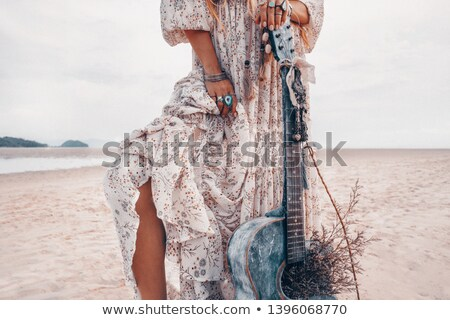 Closeup of female legs with guitar  Stock photo © Elisanth