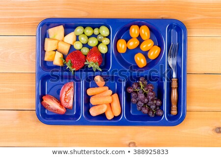 fruit sampler in lunch tray with fork stock photo © ozgur