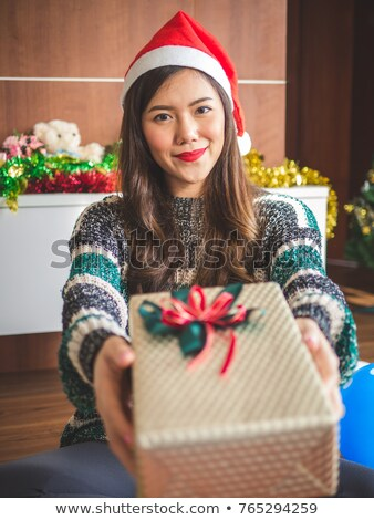 Stock photo: Woman in party hat holding present box