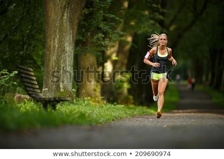 Girl in wet singlet Stock photo © bezikus