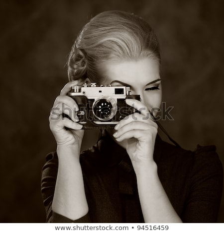 Beautiful lady with retro photo camera Stock photo © svetography