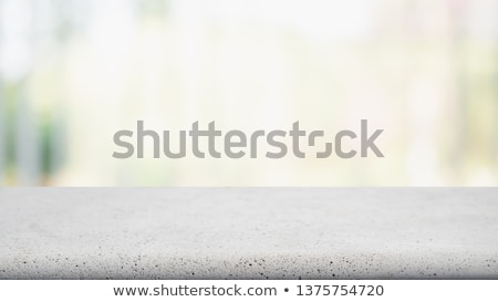 Stock photo: Concrete table top with blurred coffee shop