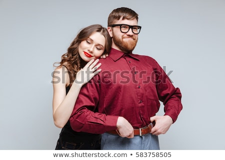 Girl lying on shoulder of man stock photo © deandrobot