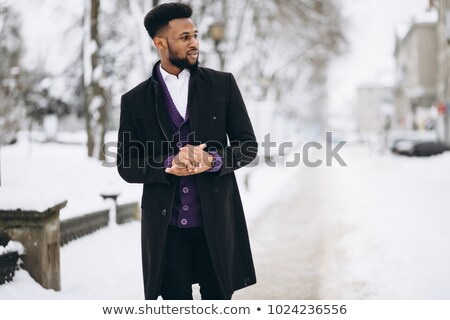 Stylish man in black coat Stock photo © Giulio_Fornasar