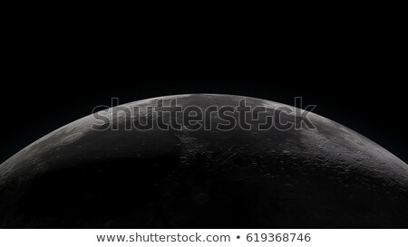 Moon horizon with partially lit surface Stock photo © Noedelhap