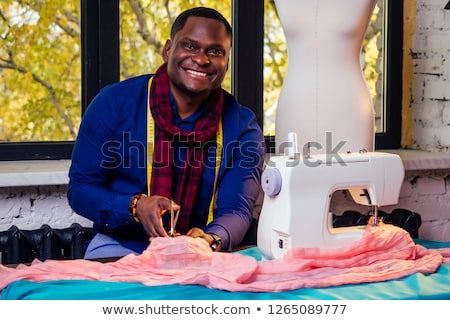 smiling tailor with mannequin stock photo © dash