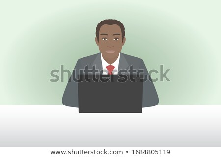 African man sitting by the table stock photo © deandrobot