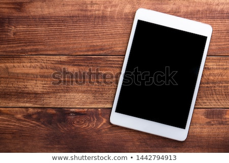 digital tablet on wooden table stock photo © andreypopov