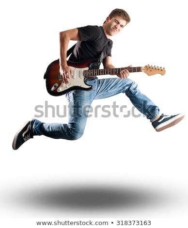 Jeunes élégant guitariste sautant stade homme Photo stock © konradbak