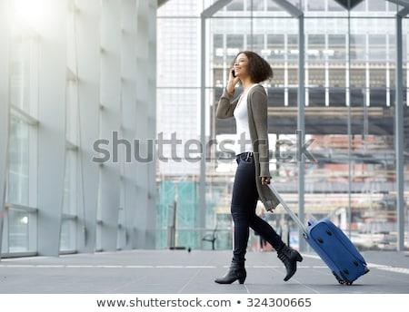 Uśmiechnięta kobieta bagażu portret patrząc kamery Zdjęcia stock © LightFieldStudios