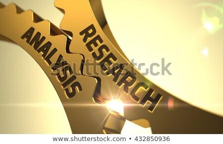 golden metallic cog gears with analysis information concept stock photo © tashatuvango