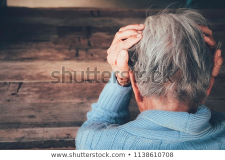 Disappointed man crying with head in hands Stock photo © stevanovicigor