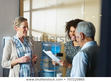 Casual meeting by office water cooler Stock photo © IS2
