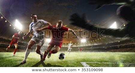 Voetballer jongleren voetbal grond gras fitness Stockfoto © wavebreak_media