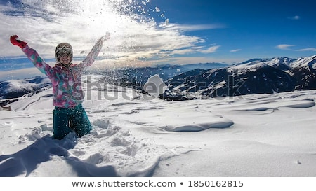 Female snowboarder playing around in the Stock photo © IS2