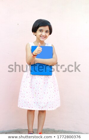 young girl standing on books Stock photo © IS2