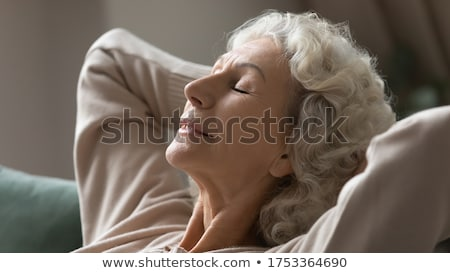 Mature lady Sleeping on couch Stock photo © IS2