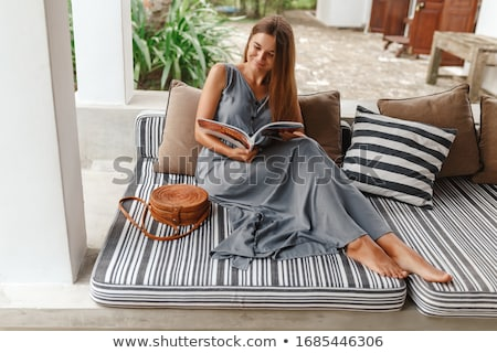 Woman reading a journal Stock photo © IS2
