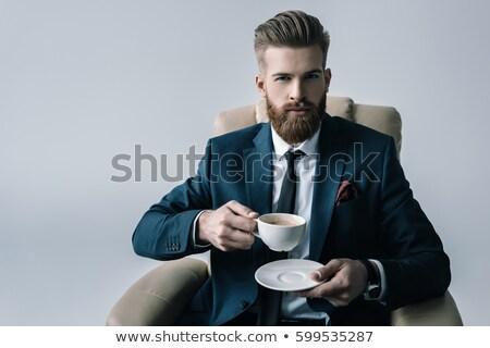 europeu · empresário · xícara · de · café · trabalhando · escritório · secretário - foto stock © studioworkstock