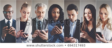 Businesspeople text messaging Stock photo © IS2
