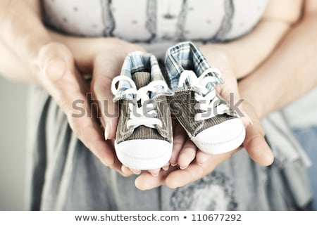 Couple holding a pair of baby booties Stock photo © IS2