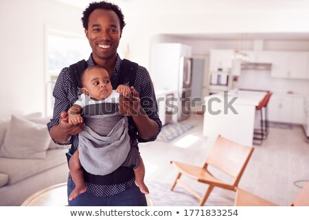 Father with 5 month old baby in sling Stock photo © IS2