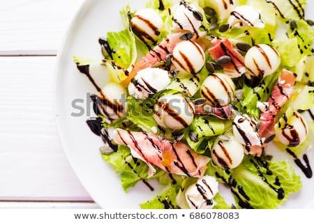 Dinnye saláta mozzarella sonka háttér fehér Stock fotó © M-studio