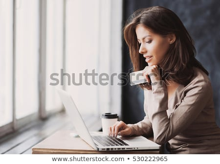 young smiling woman shopping online stock photo © hannamonika