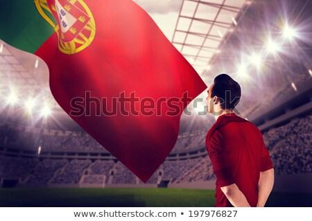 Futbolista digitalmente generado bandera hierba hombre Foto stock © wavebreak_media