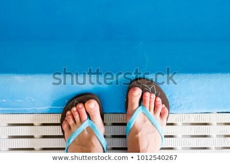 Papucs úszómedence férfi női tengerpart nyár Stock fotó © magraphics