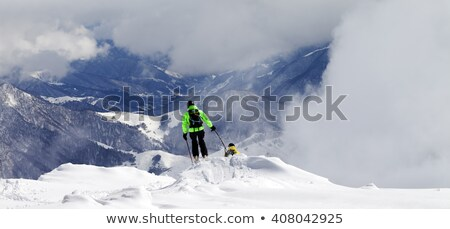 freeriders on off piste slope and mountains in mist stock photo © bsani